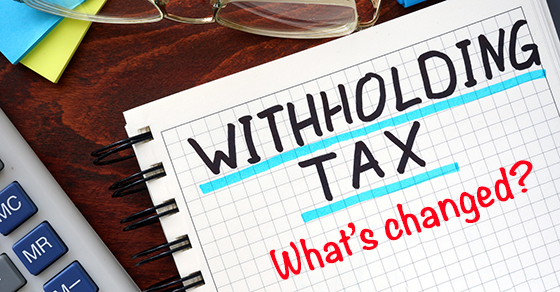 Paper with the word WITHHOLDING TAX