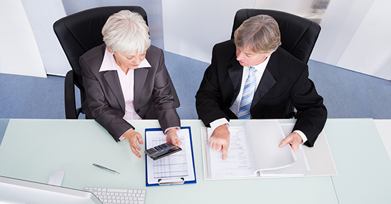 2 business people sitting at a desk