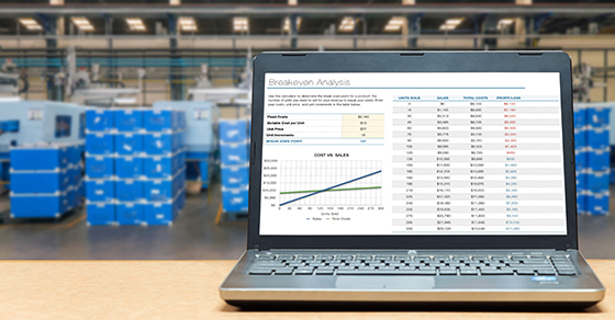 Laptop with spreadsheet in a warehouse
