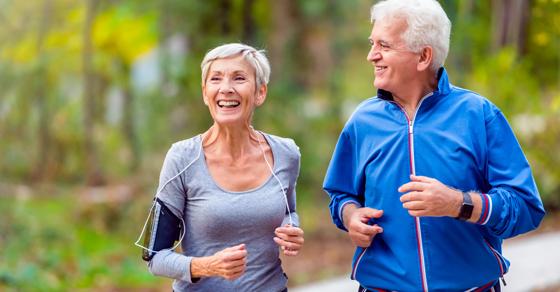 Older couple exercising outside