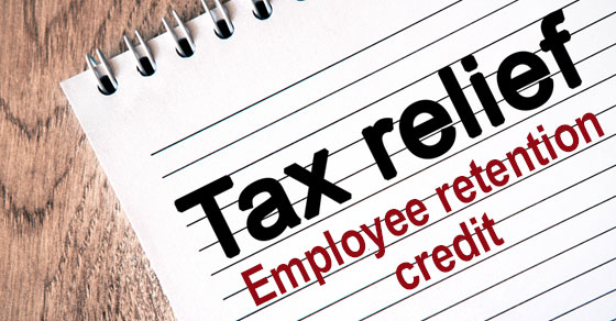 Notepad with word TAX RELIEF EMPLOYEE RETENTION CREDIT