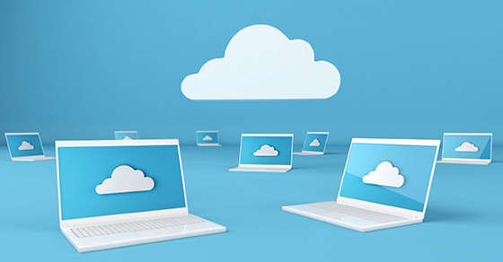 Many laptop computers with picture of a cloud on the screen