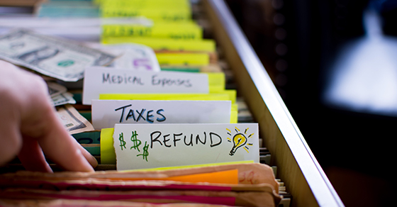 File folders with the word REFUND