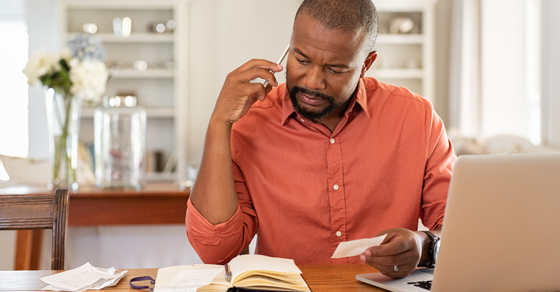 Man at a desk looking at financial documents