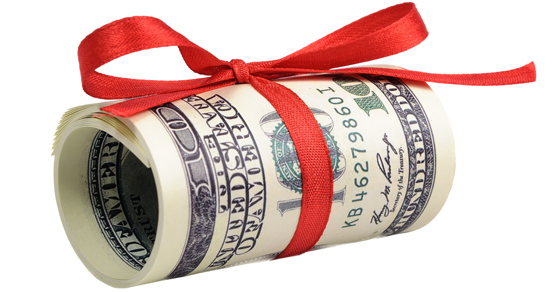 Dollar bills rolled up and wrapped with red ribbon