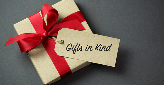 Christmas present with the words Gifts In Kind on tag