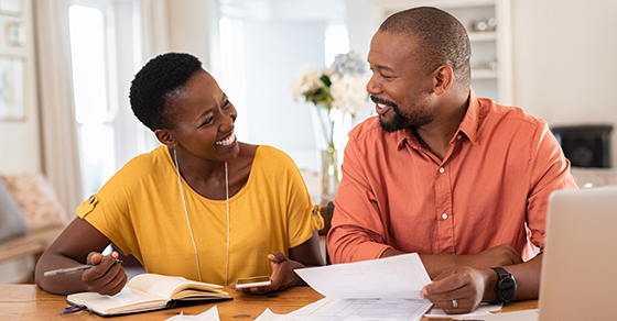 Couple discussing personal finances at a table