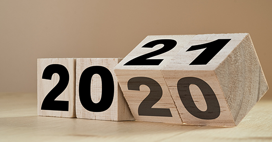Picture of wooden blocks year 2020 turning to 2021