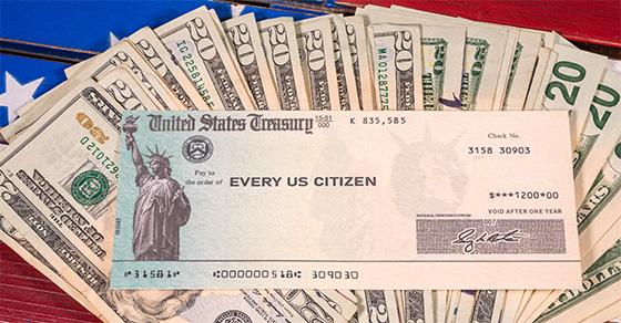 U.S. Treasury check on top of U.S. dollars
