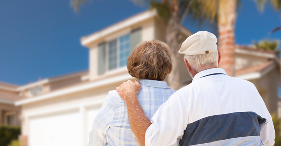Elderly couple looking at house